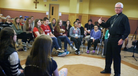 MEETING WITH 'RADIATERS'  Bishop reminds teens of their calling, need for youths to be good leaders