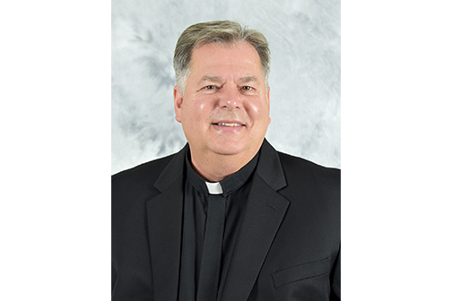40 Years: Priest, lawyer and educator has served diocese for four decades