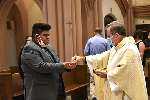 Local parishes begin hosting small groups for public Masses