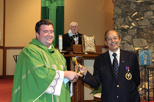 Fourth Degree Knights present chalice to new priest at special Mass
